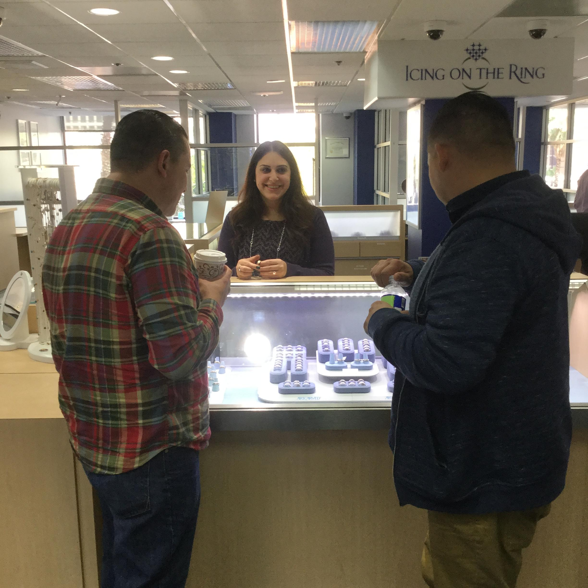Ani from Icing On The Ring showing rings to potential customers